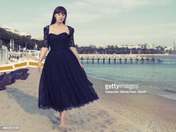 Monica Bellucci wearing a Dolce Gabbana dress is photographed for Paris Match on the beach of the Hotel Martinez during the 67th Cannes Film Festival...