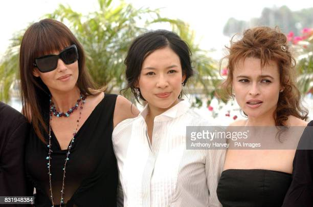 Monica Bellucci Zhang Ziyi and Helena Bonham Carter pose for photographers during the photocall for the Cannes Jury in the Palais du Festival Cannes