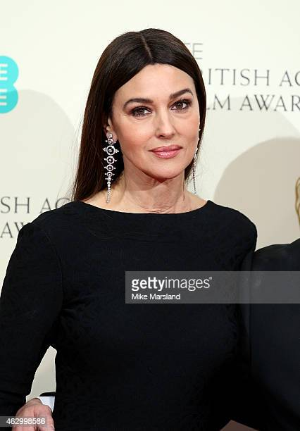Monica Belluci poses in the winners room at the EE British Academy Film Awards at The Royal Opera House on February 8 2015 in London England