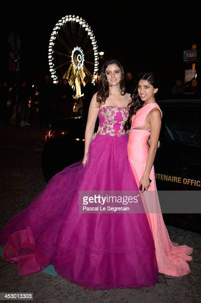 Monica Chartouni in a Reem Acra dress and an unidentified debutante pose as they arrive to attend the 2013 Debutantes Ball at Automobile Club De...