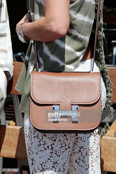 Monica Hermes handbag detail wears a Maje suit a Bulgari wristwatch a sandals from Formentera market and Cristina wears a Seventees top a Maje...