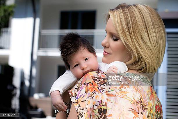 Monica Ivancan and her baby daughter Rosa pose during a private portrait session on June 13 2013 in Munich Germany