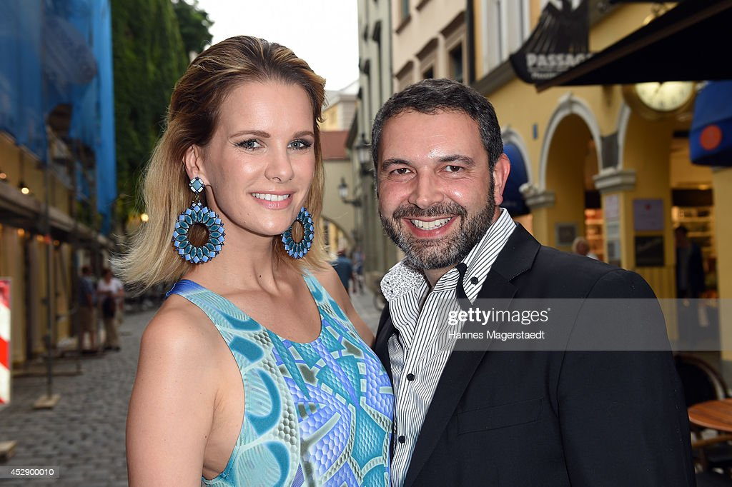 <a gi-track='captionPersonalityLinkClicked' href=/galleries/search?phrase=Monica+Ivancan&family=editorial&specificpeople=3949859 ng-click='$event.stopPropagation()'>Monica Ivancan</a> and Pedro da Silva attend the Marcus Heinzelmann Boutique Opening on July 29, 2014 in Munich, Germany.