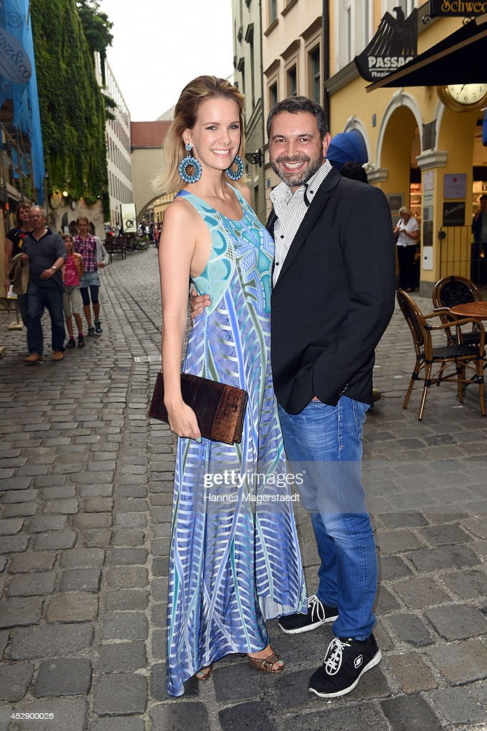 Monica Ivancan and Pedro da Silva attend the Marcus Heinzelmann Boutique Opening on July 29, 2014 in Munich, Germany.