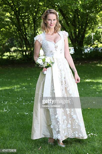 Monica Ivancan wearing a wedding dirndl by Astrid Soell poses during a photo session on May 11 2015 in Munich Germany