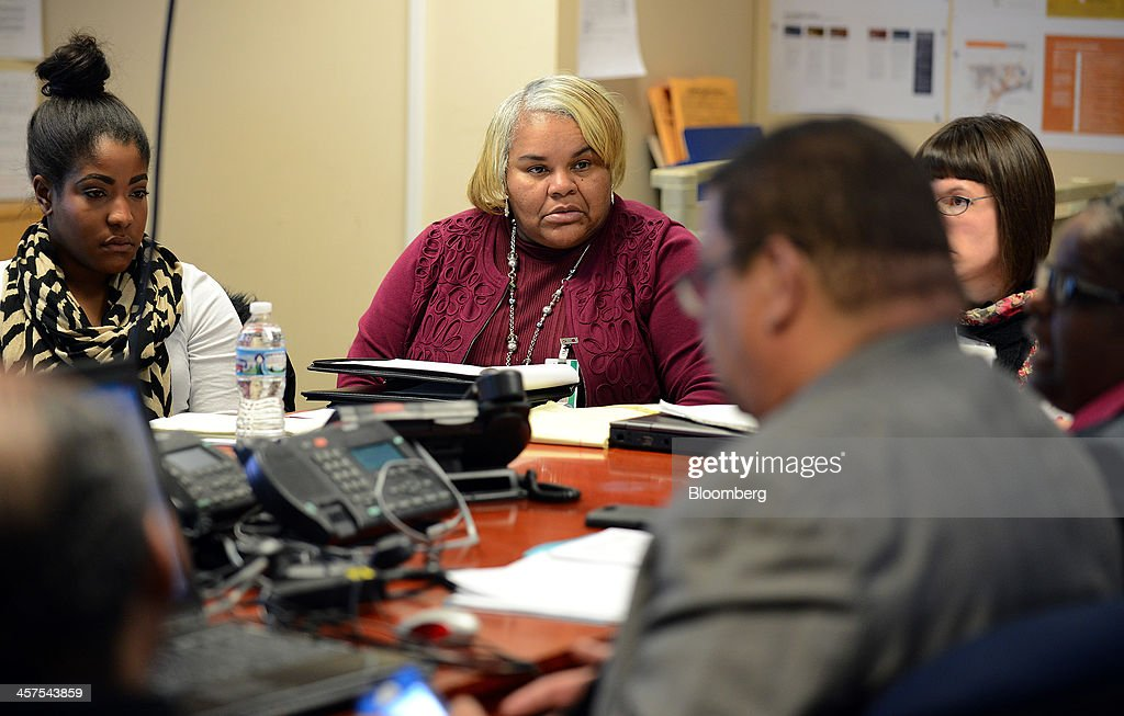 Monica Johnson, from the Office of Parent Engagement at the Detroit Public Schools (DPS), listens during a strategy meeting in the 'war room' at DPS offices in Detroit, Michigan, U.S., on Wednesday, Dec. 11, 2013. An all-out battle to attract Detroits dwindling pool of students is engulfing the citys competing schools even as plans for a civic renaissance count on them to retain residents and stabilize neighborhoods. Photographer: Bryan Mitchell/Bloomberg via Getty Images
