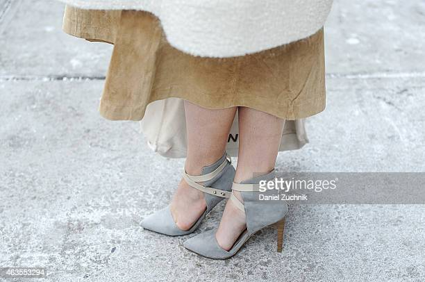 Monica Kay is seen outside the DKNY show wearing a vintage skirt own design coat and Just Fab shoes on February 15 2015 in New York City