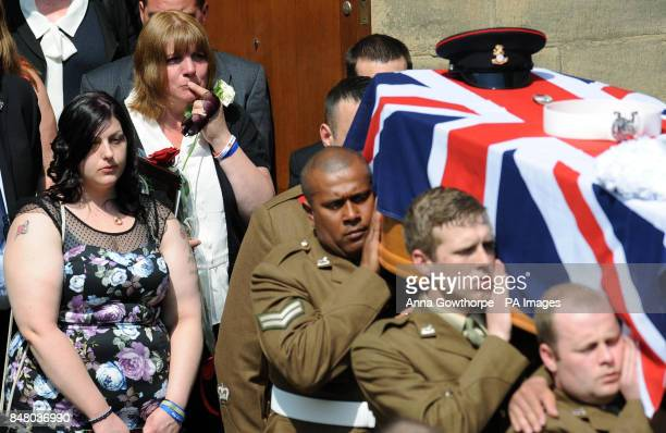 Monica Kershaw mother of Private Christopher Kershaw holds a white rose as she follows his coffin out of Holy Trinity Church Idle Bradford after his...