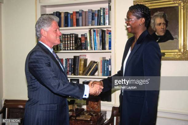 Monica Lamb of the Houston Comets shakes hands with President Bill Clinton circa 2000 at the White House in Washington DC NOTE TO USER User expressly...