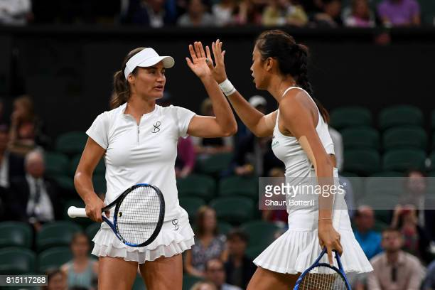Monica Niculescu of Romania and HaoChing Chan of Chinese Taipei celebrate in the Ladies Doubles Final against Ekaterina Makarova and Elena Vesnina of...