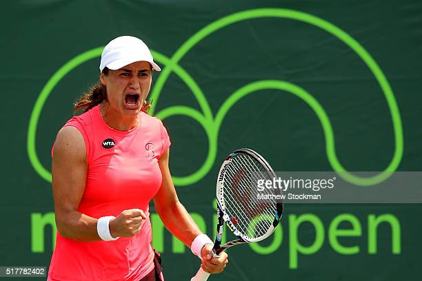 Monica Niculescu of Romania celebrates against Coco Vandeweghe of the United States during the Miami Open presented by Itau at Crandon Park Tennis...