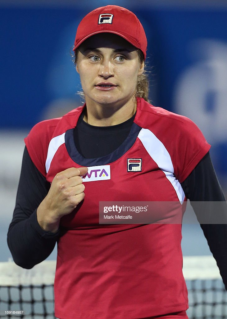 <a gi-track='captionPersonalityLinkClicked' href=/galleries/search?phrase=Monica+Niculescu&family=editorial&specificpeople=2326066 ng-click='$event.stopPropagation()'>Monica Niculescu</a> of Romania celebrates winning match point in her second round match against Shuai Peng of China during day six of the Hobart International at Domain Tennis Centre on January 9, 2013 in Hobart, Australia.