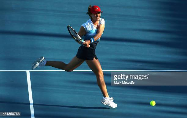 Monica Niculescu of Romania hits a backhand in her second round match against Mona Barthel of Germany during day four of the Moorilla Hobart...