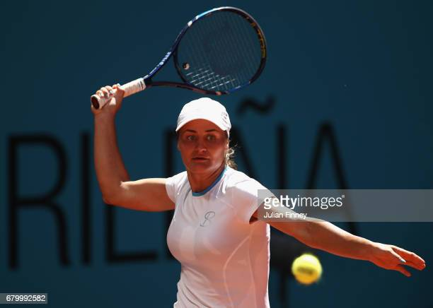 Monica Niculescu of Romania in action against Caroline Wozniacki of Denmark during day two of the Mutua Madrid Open tennis at La Caja Magica on May 7...