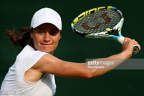 Monica Niculescu of Romania in action during her Ladies' Singles first round match against Alison Van Uytvanck of Belgium on day one of the Wimbledon...