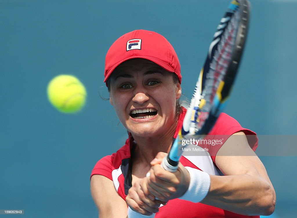 Monica Niculescu of Romania plays a backhand in her first round match against Mandy Minella of Luxembourg during day four of the Hobart International at Domain Tennis Centre on January 7, 2013 in Hobart, Australia.