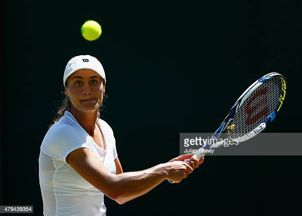 Monica Niculescu of Romania plays a backhand in her Ladies' Singles Third Round match against Karolina Pliskova of Czech Republic during day six of...
