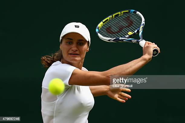 Monica Niculescu of Romania plays a backhand in her Ladies' Singles Fourth Round match against Timea Bacsinszky of Switzerland during day seven of...