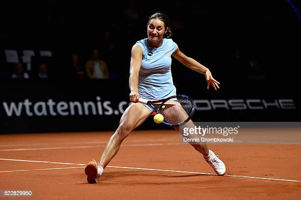 Monica Niculescu of Romania plays a backhand in her match against Petra Kvitova of Czech Republic during Day 4 of the Porsche Tennis Grand Prix at...