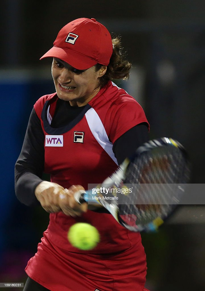 Monica Niculescu of Romania plays a backhand in her second round match against Shuai Peng of China during day six of the Hobart International at Domain Tennis Centre on January 9, 2013 in Hobart, Australia.
