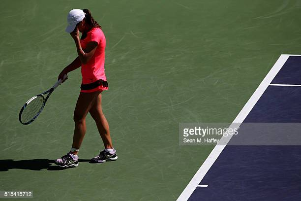 Monica Niculescu of Romania reacts to a shot by Agnieszka Radwanska of Poland during the BNP Paribas Open at the Indian Wells Tennis Garden on March...