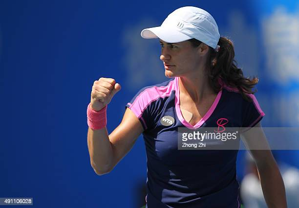 Monica Niculescu of Romania reacts to IrinaCamelia Begu of Romania during the doubles final match against Martina Hingis of Switzerland with Sania...