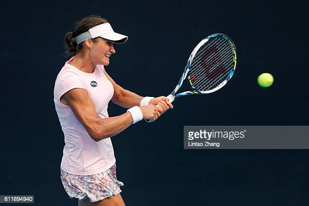 Monica Niculescu of Romania returns a shot against Louisa Chirico of United States during the Women's singles first round match on day one of the...
