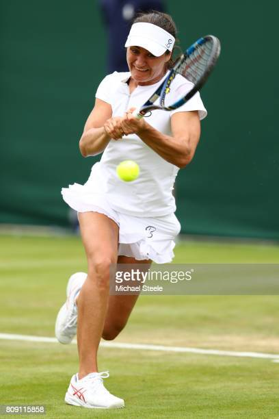 Monica Niculescu of Romania returns a shot during her ladies' singles first round match against Magdalena Rybarikova of Slovakia on day two of the...