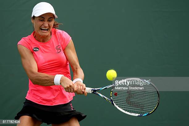 Monica Niculescu of Romania returns a shot to Coco Vandeweghe of the United States during the Miami Open presented by Itau at Crandon Park Tennis...
