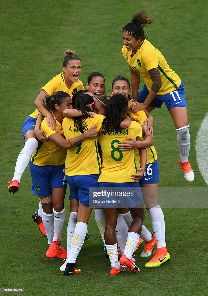 Monica of Brazil celebrates with team mates as she scores their first goal during the Women's Group E first round match between Brazil and China PR...