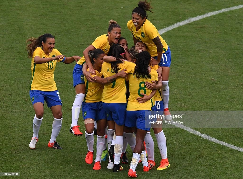 Monica of Brazil celebrates with teammates after scoring against China during the Rio 2016 Olympic Games womens first round Group E football match...