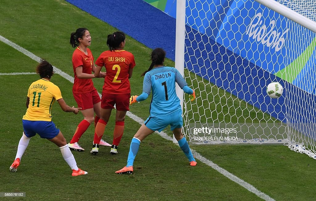 Monica of Brazil scores a goal against goalkeeper Zhao Lina of China during the Rio 2016 Olympic Games womens first round Group E football match...