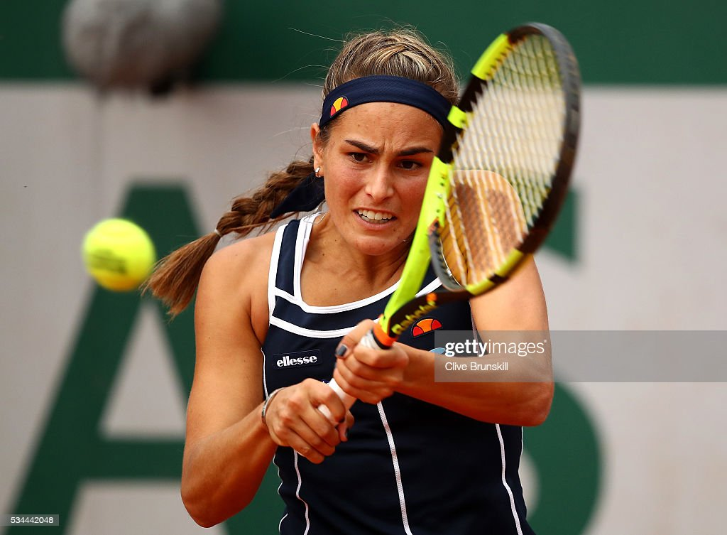 <a gi-track='captionPersonalityLinkClicked' href=/galleries/search?phrase=Monica+Puig&family=editorial&specificpeople=6672407 ng-click='$event.stopPropagation()'>Monica Puig</a> of Puerto Rica hits a backhand during the Ladies Singles second round match against Julia Goerges of Germany on day five of the 2016 French Open at Roland Garros on May 26, 2016 in Paris, France.