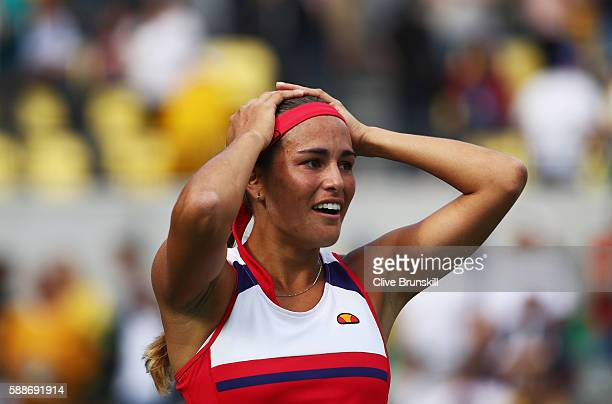 Monica Puig of Puerto Rico celebrates after defeating Petra Kvitova of the Czech Republic during the Women's Singles Semifinal on Day 7 of the Rio...