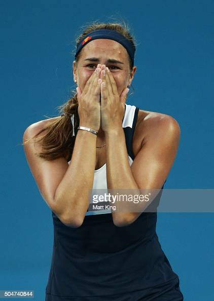 Monica Puig of Puerto Rico celebrates winning match point in her match against Samantha Stosur of Australia during day four of the Sydney...
