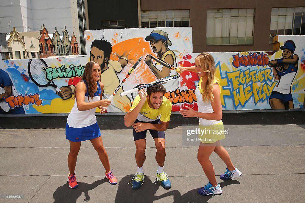 Monica Puig of Puerto Rico, <a gi-track='captionPersonalityLinkClicked' href=/galleries/search?phrase=Feliciano+Lopez&family=editorial&specificpeople=206172 ng-click='$event.stopPropagation()'>Feliciano Lopez</a> of Spain and <a gi-track='captionPersonalityLinkClicked' href=/galleries/search?phrase=Elina+Svitolina&family=editorial&specificpeople=7026504 ng-click='$event.stopPropagation()'>Elina Svitolina</a> of Ukraine pose after painting street art with Melbourne graffiti artist Daniel Wenn (unseen) during the ellesse Tennis Performance Apparel Launch on January 17, 2014 in Melbourne, Australia. The new range of tennis performance apparel will be worn by <a gi-track='captionPersonalityLinkClicked' href=/galleries/search?phrase=Feliciano+Lopez&family=editorial&specificpeople=206172 ng-click='$event.stopPropagation()'>Feliciano Lopez</a>, <a gi-track='captionPersonalityLinkClicked' href=/galleries/search?phrase=Elina+Svitolina&family=editorial&specificpeople=7026504 ng-click='$event.stopPropagation()'>Elina Svitolina</a> and Monica Puig at the Australian Open.