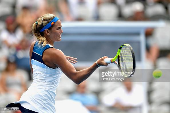 Monica Puig of Puerto Rico plays a forehand shot in her first round match against Caroline Wozniacki of Denmark during day two of the 2017 Sydney...