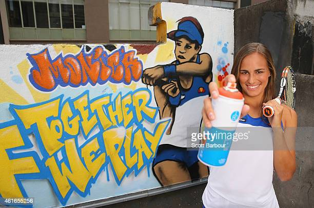 Monica Puig of Puerto Rico poses with a can of spray paint after painting street art with Melbourne graffiti artist Daniel Wenn during the ellesse...