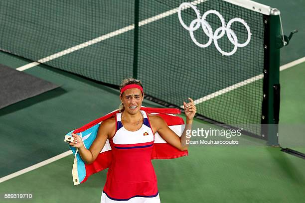 Monica Puig of Puerto Rico reacts after defeating Angelique Kerber of Germany in the Women's Singles Gold Medal Match on Day 8 of the Rio 2016...