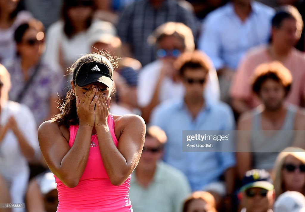 Monica Puig of Puerto Rico reacts against Andrea Petkovic of Germany during their women's singles second round match on Day Three of the 2014 US Open at the USTA Billie Jean King National Tennis Center on August 27, 2014 in the Flushing neighborhood of the Queens borough of New York City.