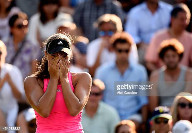 Monica Puig of Puerto Rico reacts against Andrea Petkovic of Germany during their women's singles second round match on Day Three of the 2014 US Open...