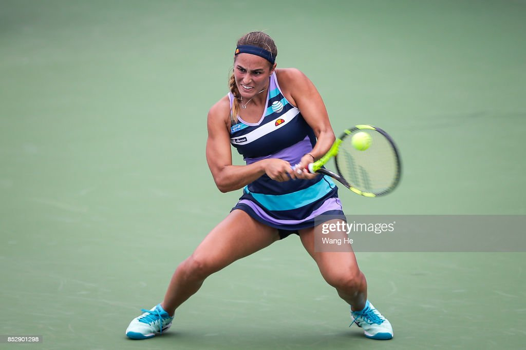 Monica Puig of Puerto Rico returns a shot during the match against Mona Barthel of Germany on Day 1 of 2017 Dongfeng Motor Wuhan Open at Optics Valley International Tennis Center on September 24, 2017 in Wuhan, China.