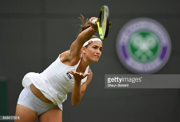 Monica Puig of Puerto Rico serves during the Ladies Singles first round match gainst Johanna Konta of Great Britain on day two of the Wimbledon Lawn...
