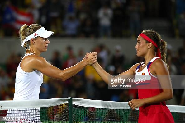 Monica Puig of Puerto Rico shakes hands with Angelique Kerber of Germany after the Women's Singles Gold Medal Match on Day 8 of the Rio 2016 Olympic...