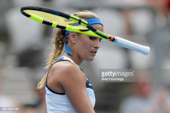 Monica Puig of Puerto Rico throws her racquet in her first round match against Caroline Wozniacki of Denmark during day two of the 2017 Sydney...