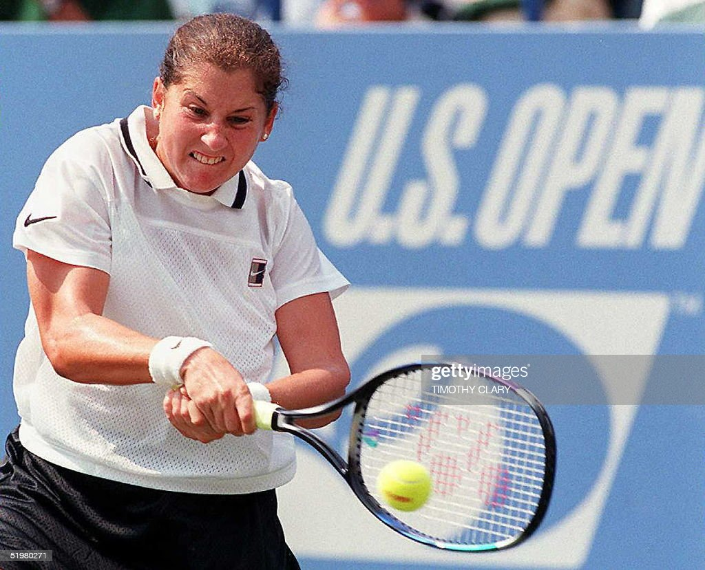 Monica Seles of the US returns a shot to Steffi Gr