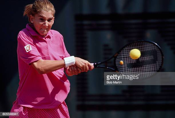 Monica Seles of Yugoslavia makes a double back hand return during the Women's Singles Semi Final match against Steffi Graf at the French Open Tennis...