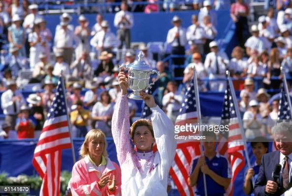 Monica Seles raises the winning trophy after defeating Martina Navratilova in the 1991 US Open Championship at USTA National Tennis Center in...