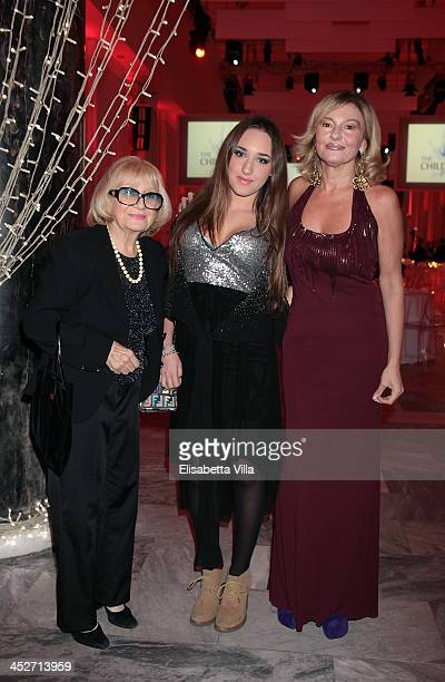 Monica Setta right with her mother and daughter attends The Children For Peace Benefit Gala Ceremony at Spazio Novecento on November 30 2013 in Rome...