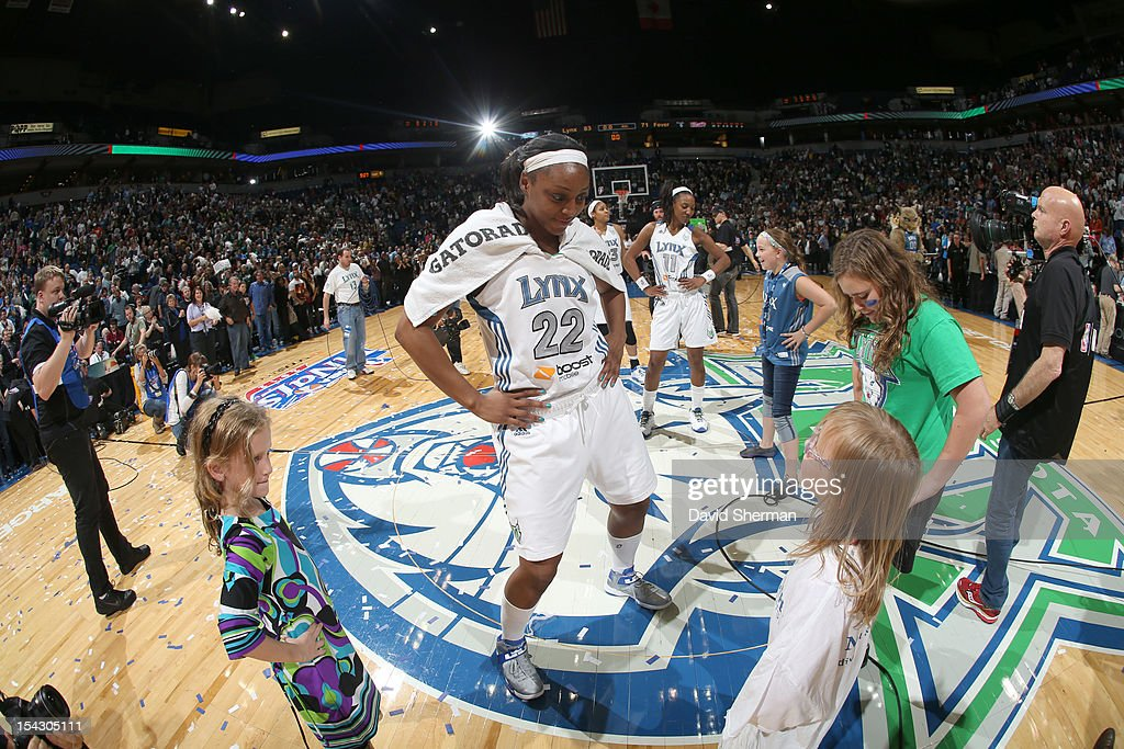 Monica Wright #22 and <a gi-track='captionPersonalityLinkClicked' href=/galleries/search?phrase=Candice+Wiggins&family=editorial&specificpeople=2999713 ng-click='$event.stopPropagation()'>Candice Wiggins</a> #11 of the Minnesota Lynx celebrate with fans after the 2012 WNBA Finals Game Two win over the Indiana Fever on October 17, 2012 at Target Center in Minneapolis, Minnesota.